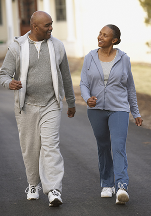 Middle-aged man and woman walking.