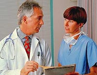 Picture of a physician and nurse reviewing a patient