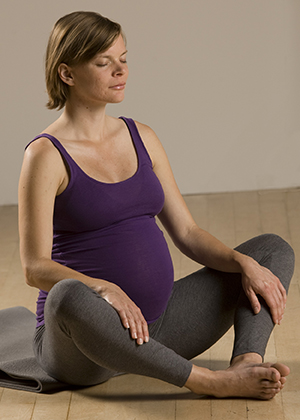 Pregnant woman doing yoga.