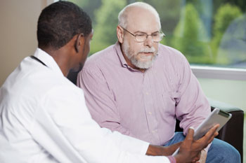 Man talking with a doctor